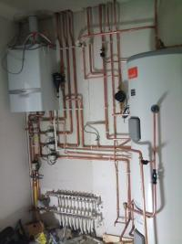 Boiler and unvented hot water cylinder installed