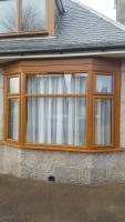 Upvc light oak bay window