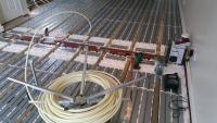 Underfloor heating between joist system