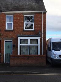 White UPVC Windows, Chartwell Green Composite door - Bourne