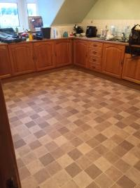 Uplifted kitchen and bathroom water affected chipboa flooring  and replace floors and fit new vynil after flooding.