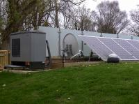 Air source heat pump installation with PV on a converted Reservoir