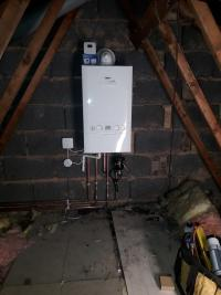 New Combi boiler installation relocated to loft