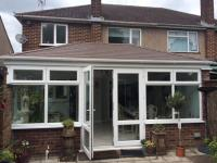 Finished conversion with new tiled insulated conservatory roof