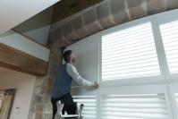 Fitting special shaped window shutters