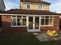 A large double hipped Edwardian conservatory